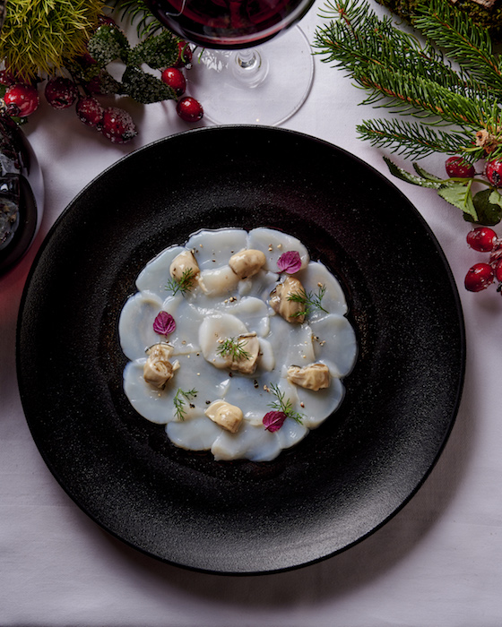 Carpaccio de Saint-Jacques et huîtres à l'huile de curry
